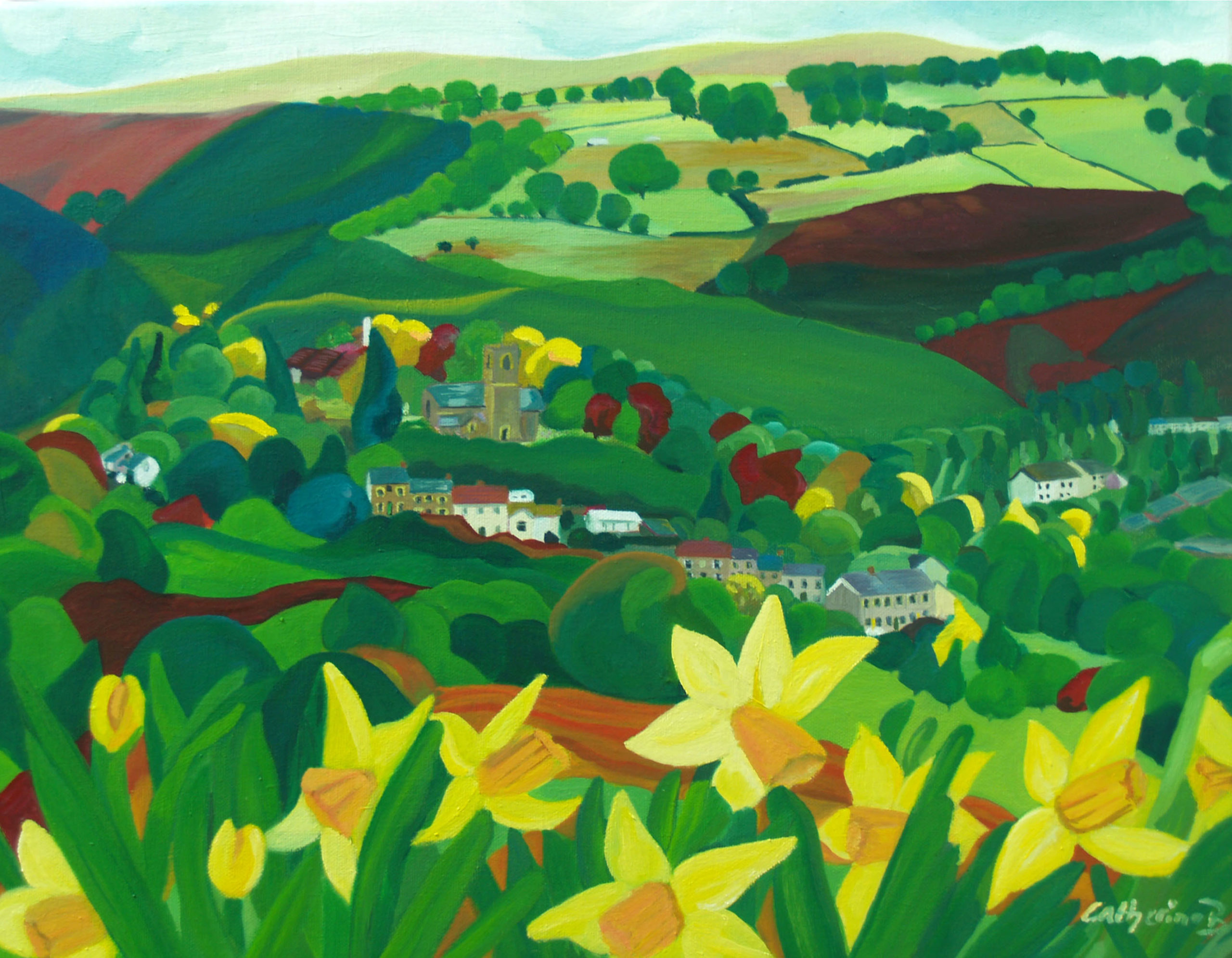 rolling hills and daffodils with a village tucked in the valley